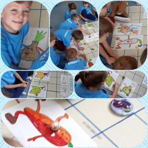 Kolaż : zdjęcia dzieci i zdrowych warzyw. Koderki zaprogramowały kolorową trasę za pomocą.